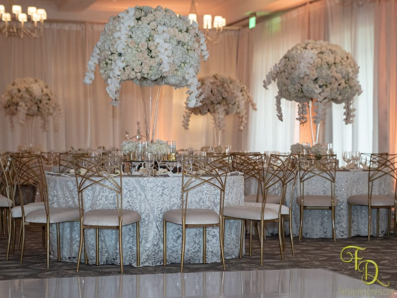 Hydrangeas Orchids and Roses were used to make these arrangements amazing